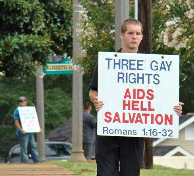 Street preachers hold signs condemning homosexulaity on public sidewalk (photo: Chris Pettigrew)