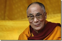 The Dalai Lama watches a dance performance on Thursday. Chinese spokesman, Qin Gang, drew suggestive parallels between the Dalai Lama and slave owners in America's history. Mr. Qin also suggested President Obama's own skin color should make him sympathetic to Beijing's opposition to the Dalai Lama.