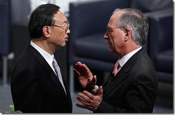 China's Foreign Minister Yang Jiechi is welcomed by Wolfgang Ischinger, chairman of the Conference on Security Friday before the start of the 46th Conference on Security Policy in Munich. Speaking with uncharacteristic bluntness, Mr. Yang accused the US of violating international law with its proposed arms sale to Taiwan.